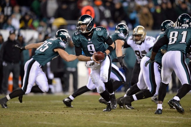 Jan 4, 2014; Philadelphia, PA, USA; Philadelphia Eagles quarterback Nick Foles (9) runs a play against the New Orleans Saints during the 2013 NFC wild card playoff football game at Lincoln Financial Field. The New Orleans Saints won the game 26-24. Mandatory Credit: Joe Camporeale-USA TODAY Sports