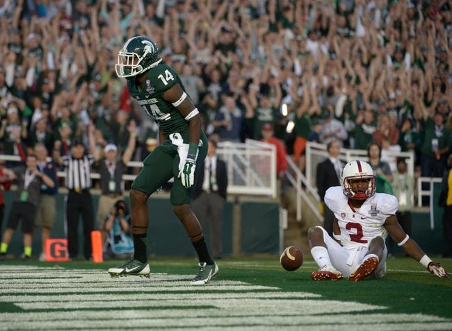Jan 1, 2014; Pasadena, CA, USA; Michigan State Spartans receiver Tony Lippett (14) celebrates after scoring on a 25-yard touchdown reception in the fourth quarter as Stanford Cardinal cornerback Wayne Lyons (2) reacts in the 100th Rose Bowl. Michigan State defeated Stanford 24-20. Mandatory Credit: Kirby Lee-USA TODAY Sports