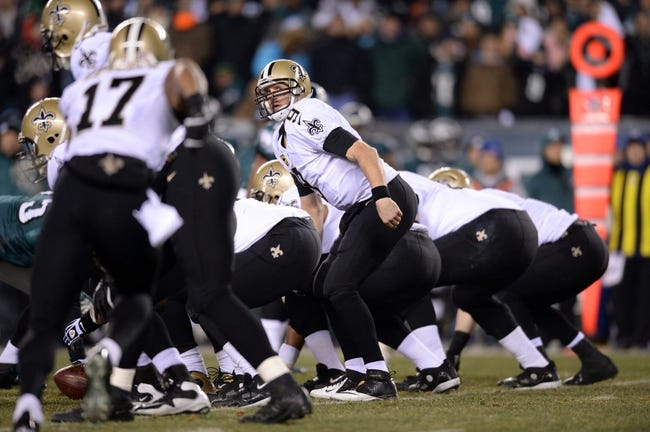 Jan 4, 2014; Philadelphia, PA, USA; New Orleans Saints quarterback Drew Brees (9) calls a play against the Philadelphia Eagles during the first half of the 2013 NFC wild card playoff football game at Lincoln Financial Field. The New Orleans Saints won the game 26-24. Mandatory Credit: Joe Camporeale-USA TODAY Sports