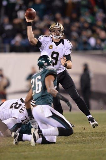 Jan 4, 2014; Philadelphia, PA, USA; New Orleans Saints quarterback Drew Brees (9) throws a pass against the Philadelphia Eagles during the 2013 NFC wild card playoff football game at Lincoln Financial Field. The New Orleans Saints won the game 26-24. Mandatory Credit: Joe Camporeale-USA TODAY Sports