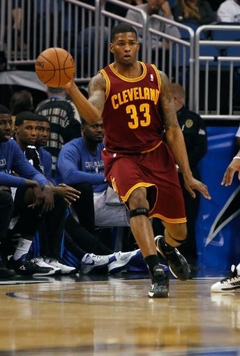 Dec 13, 2013; Orlando, FL, USA; Cleveland Cavaliers small forward Alonzo Gee (33) passes the ball against the Orlando Magic during the second half at Amway Center. Cleveland Cavaliers defeated the Orlando Magic 109-100. Mandatory Credit: Kim Klement-USA TODAY Sports