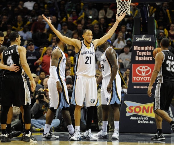 Jan 7, 2014; Memphis, TN, USA; Memphis Grizzlies small forward Tayshaun Prince (21) reacts to a call during the game against the San Antonio Spurs at FedExForum. the San Antonio Spurs beat the Memphis Grizzlies 110 - 108 Mandatory Credit: Justin Ford-USA TODAY Sports