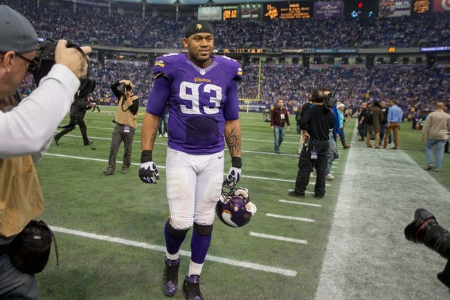 Dec 29, 2013; Minneapolis, MN, USA; Minnesota Vikings defensive tackle Kevin Williams (93) leaves the field after the game with the Detroit Lions at Mall of America Field at H.H.H. Metrodome. The Vikings win 14-13. Mandatory Credit: Bruce Kluckhohn-USA TODAY Sports