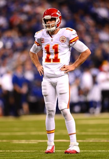 Jan 4, 2014; Indianapolis, IN, USA; Kansas City Chiefs quarterback Alex Smith (11) during the 2013 AFC wild card playoff football game against the Indianapolis Colts at Lucas Oil Stadium. Mandatory Credit: Andrew Weber-USA TODAY Sports