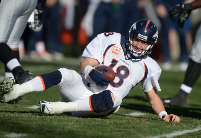 Dec 29, 2013; Oakland, CA, USA; Denver Broncos quarterback Peyton Manning (18) during the game against the Oakland Raiders at O.co Coliseum. The Broncos defeated the Raiders 34-14. Mandatory Credit: Kirby Lee-USA TODAY Sports