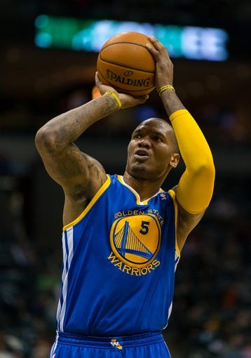 Jan 7, 2014; Milwaukee, WI, USA; Golden State Warriors forward Marreese Speights (5) during the game against the Milwaukee Bucks at BMO Harris Bradley Center.  Golden State won 101-80.  Mandatory Credit: Jeff Hanisch-USA TODAY Sports