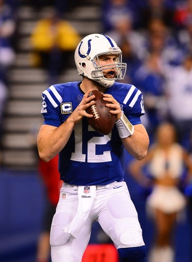 Jan 4, 2014; Indianapolis, IN, USA; Indianapolis Colts quarterback Andrew Luck (12) during the 2013 AFC wild card playoff football game against the Kansas City Chiefs at Lucas Oil Stadium. Mandatory Credit: Andrew Weber-USA TODAY Sports