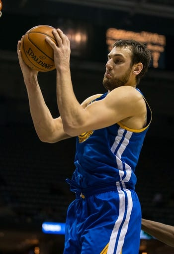 Jan 7, 2014; Milwaukee, WI, USA; Golden State Warriors center Andrew Bogut (12) during the game against the Milwaukee Bucks at BMO Harris Bradley Center.  Golden State won 101-80.  Mandatory Credit: Jeff Hanisch-USA TODAY Sports