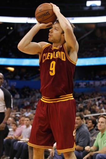 Dec 13, 2013; Orlando, FL, USA; Cleveland Cavaliers shooting guard Matthew Dellavedova (9) shoots against the Orlando Magic during the second quarter at Amway Center. Mandatory Credit: Kim Klement-USA TODAY Sports
