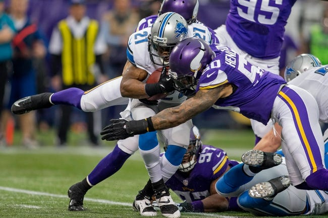 Dec 29, 2013; Minneapolis, MN, USA; Minnesota Vikings linebacker Erin Henderson (50) tackles Detroit Lions running back Reggie Bush (21) as he rushes in the first quarter at Mall of America Field at H.H.H. Metrodome. The Vikings win 14-13. Mandatory Credit: Bruce Kluckhohn-USA TODAY Sports