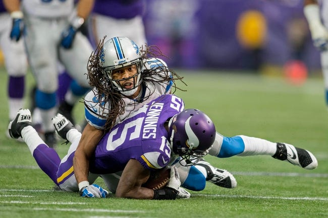 Dec 29, 2013; Minneapolis, MN, USA; Detroit Lions defensive back Rashean Mathis (31) tackles Minnesota Vikings wide receiver Greg Jennings (15) on a pass in the second quarter at Mall of America Field at H.H.H. Metrodome. The Vikings win 14-13. Mandatory Credit: Bruce Kluckhohn-USA TODAY Sports