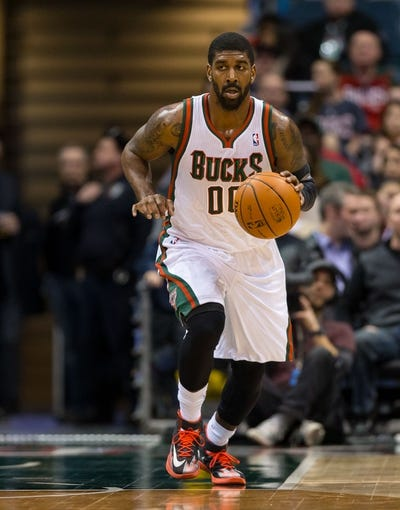 Jan 7, 2014; Milwaukee, WI, USA; Milwaukee Bucks guard O.J. Mayo (00) during the game against the Golden State Warriors at BMO Harris Bradley Center.  Golden State won 101-80.  Mandatory Credit: Jeff Hanisch-USA TODAY Sports