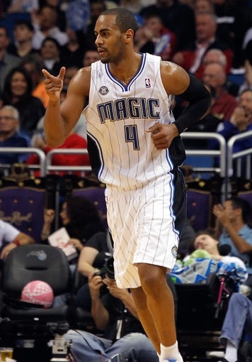 Dec 13, 2013; Orlando, FL, USA; Orlando Magic shooting guard Arron Afflalo (4) points after they made a basket against the Cleveland Cavaliers during the second quarter at Amway Center. Mandatory Credit: Kim Klement-USA TODAY Sports