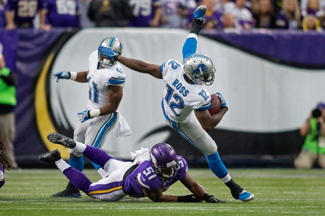 Dec 29, 2013; Minneapolis, MN, USA; Minnesota Vikings linebacker Larry Dean (51) up ends Detroit Lions wide receiver Jeremy Ross (12) on a punt return in the first quarter at Mall of America Field at H.H.H. Metrodome. The Vikings win 14-13. Mandatory Credit: Bruce Kluckhohn-USA TODAY Sports
