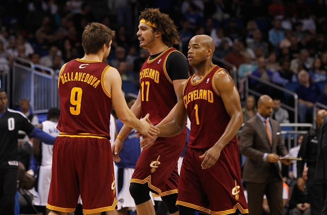 Dec 13, 2013; Orlando, FL, USA; Cleveland Cavaliers point guard Jarrett Jack (1), center Anderson Varejao (17) and  shooting guard Matthew Dellavedova (9) high five against the Orlando Magic during the second quarter at Amway Center. Mandatory Credit: Kim Klement-USA TODAY Sports