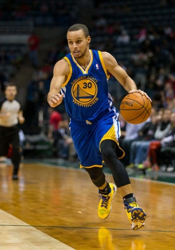 Jan 7, 2014; Milwaukee, WI, USA; Golden State Warriors guard Stephen Curry (30) during the game against the Milwaukee Bucks at BMO Harris Bradley Center.  Golden State won 101-80.  Mandatory Credit: Jeff Hanisch-USA TODAY Sports