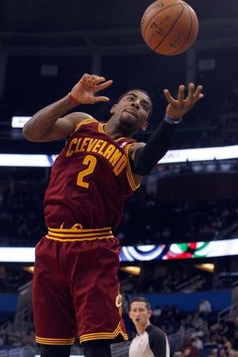 Dec 13, 2013; Orlando, FL, USA; Cleveland Cavaliers point guard Kyrie Irving (2) goes after the ball against the Orlando Magic during the first quarter at Amway Center. Mandatory Credit: Kim Klement-USA TODAY Sports