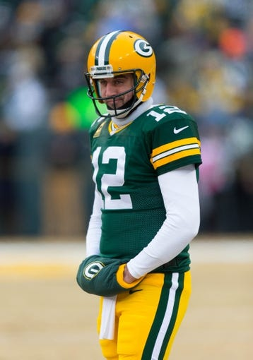 Jan 5, 2014; Green Bay, WI, USA; Green Bay Packers quarterback Aaron Rodgers (12) during warmups prior to the 2013 NFC wild card playoff football game against the San Francisco 49ers at Lambeau Field.  San Francisco won 23-20.  Mandatory Credit: Jeff Hanisch-USA TODAY Sports