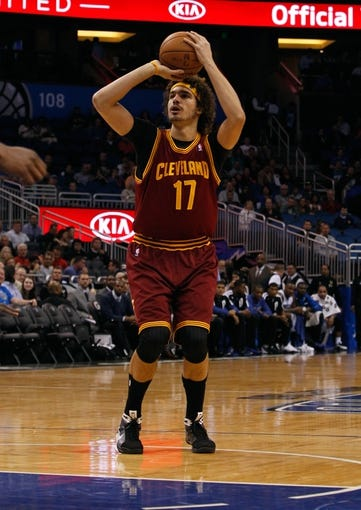 Dec 13, 2013; Orlando, FL, USA; Cleveland Cavaliers center Anderson Varejao (17) shoots against the Orlando Magic during the first quarter at Amway Center. Mandatory Credit: Kim Klement-USA TODAY Sports