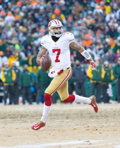 Jan 5, 2014; Green Bay, WI, USA; San Francisco 49ers quarterback Colin Kaepernick (7) during the game against the Green Bay Packers during the 2013 NFC wild card playoff football game at Lambeau Field.  San Francisco won 23-20.  Mandatory Credit: Jeff Hanisch-USA TODAY Sports