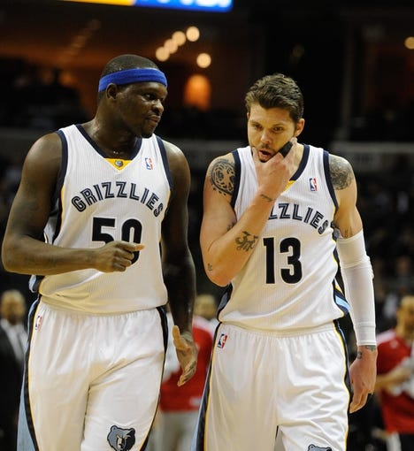 Jan 7, 2014; Memphis, TN, USA; Memphis Grizzlies power forward Zach Randolph (50) and Memphis Grizzlies small forward Mike Miller (13) talk during a timeout against the San Antonio Spurs during the first quarter at FedExForum. the San Antonio Spurs beat the Memphis Grizzlies 110 - 108 Mandatory Credit: Justin Ford-USA TODAY Sports