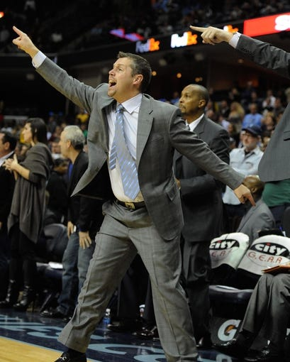Jan 7, 2014; Memphis, TN, USA; Memphis Grizzlies head coach David Joerger calling a play during the fourth quarter against the San Antonio Spurs at FedExForum. the San Antonio Spurs beat the Memphis Grizzlies 110 - 108 Mandatory Credit: Justin Ford-USA TODAY Sports