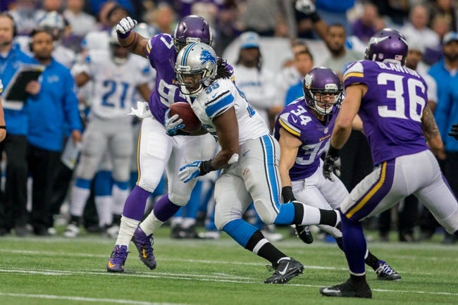 Dec 29, 2013; Minneapolis, MN, USA; Detroit Lions running back Joique Bell (35) catches a pass against the Minnesota Vikings in the third quarter at Mall of America Field at H.H.H. Metrodome. The Vikings win 14-13. Mandatory Credit: Bruce Kluckhohn-USA TODAY Sports