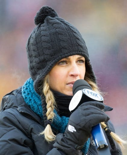 Jan 5, 2014; Green Bay, WI, USA; FOX tv announcer Erin Andrews during the 2013 NFC wild card playoff football game between the San Francisco 49ers and Green Bay Packers at Lambeau Field.  San Francisco won 23-20.  Mandatory Credit: Jeff Hanisch-USA TODAY Sports