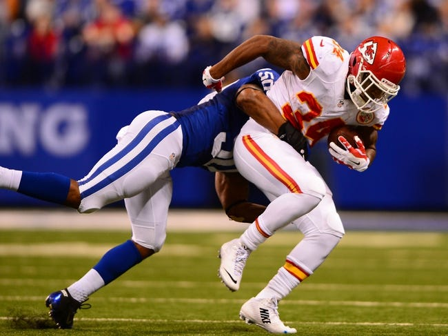 Jan 4, 2014; Indianapolis, IN, USA; Kansas City Chiefs running back Knile Davis (34) during the 2013 AFC wild card playoff football game against the Indianapolis Colts at Lucas Oil Stadium. Mandatory Credit: Andrew Weber-USA TODAY Sports
