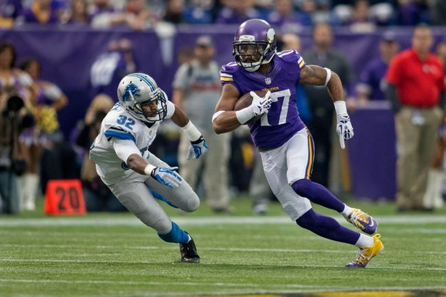 Dec 29, 2013; Minneapolis, MN, USA; Minnesota Vikings wide receiver Jarius Wright (17) passes Detroit Lions safety Don Carey (32) for a 19 yard pass reception in the first quarter at Mall of America Field at H.H.H. Metrodome. The Vikings win 14-13. Mandatory Credit: Bruce Kluckhohn-USA TODAY Sports