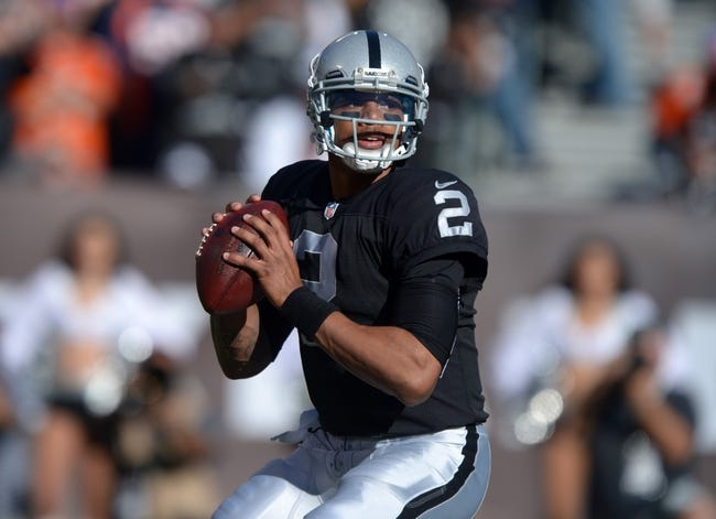 Dec 29, 2013; Oakland, CA, USA; Oakland Raiders quarterback Terrelle Pryor (2) throws a pass against the Denver Broncos at O.co Coliseum. The Broncos defeated the Raiders 34-14. Mandatory Credit: Kirby Lee-USA TODAY Sports