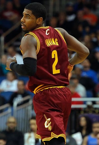 Dec 13, 2013; Orlando, FL, USA; Cleveland Cavaliers point guard Kyrie Irving (2) against the Orlando Magic during the second quarter at Amway Center. Mandatory Credit: Kim Klement-USA TODAY Sports