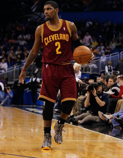 Dec 13, 2013; Orlando, FL, USA; Cleveland Cavaliers point guard Kyrie Irving (2) dribbles the ball against the Orlando Magic during the second quarter at Amway Center. Mandatory Credit: Kim Klement-USA TODAY Sports