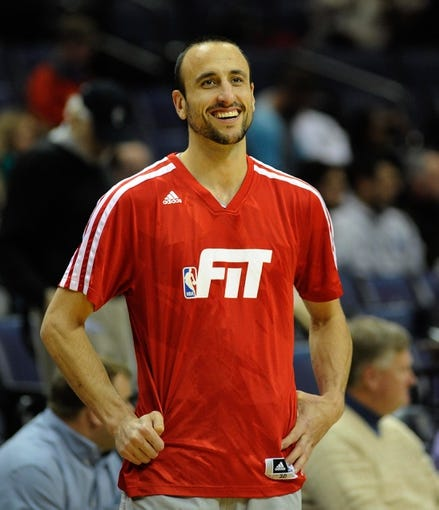 Jan 7, 2014; Memphis, TN, USA; San Antonio Spurs shooting guard Manu Ginobili (20) before the game against the Memphis Grizzlies at FedExForum. the San Antonio Spurs beat the Memphis Grizzlies 110 - 108 Mandatory Credit: Justin Ford-USA TODAY Sports