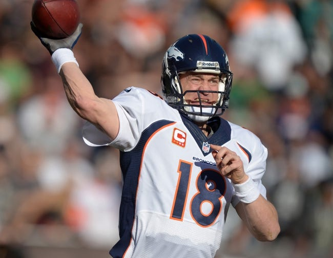 Dec 29, 2013; Oakland, CA, USA; Denver Broncos quarterback Peyton Manning (18) throws a pass in the second quarter against the Oakland Raiders at O.co Coliseum. Mandatory Credit: Kirby Lee-USA TODAY Sports