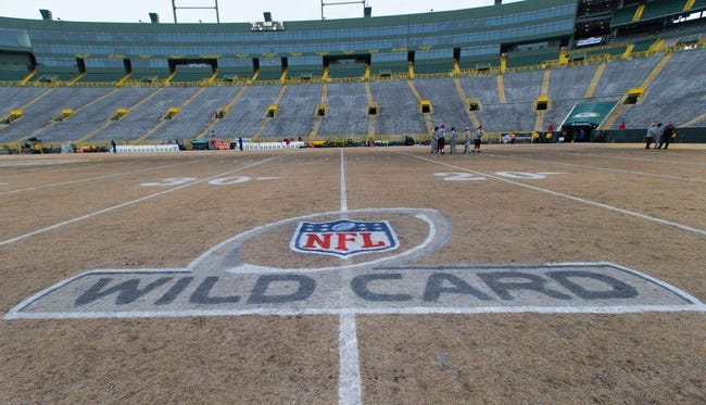 Jan 5, 2014; Green Bay, WI, USA; The NFC Wild Card logo is painted on the field prior to the 2013 NFC wild card playoff football game at between the San Francisco 49ers and Green Bay Packers Lambeau Field.  San Francisco won 23-20.  Mandatory Credit: Jeff Hanisch-USA TODAY Sports