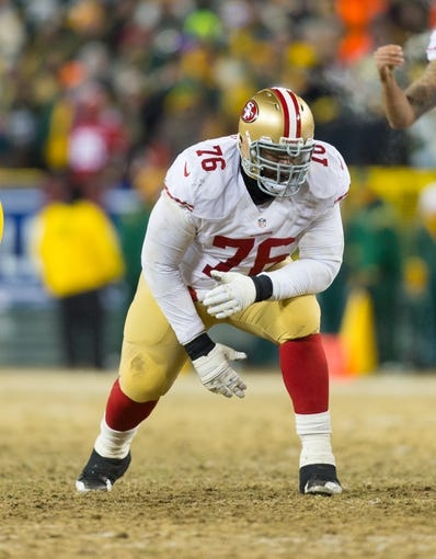 Jan 5, 2014; Green Bay, WI, USA; San Francisco 49ers offensive tackle Anthony Davis (76) during the 2013 NFC wild card playoff football game against the Green Bay Packers at Lambeau Field.  San Francisco won 23-20.  Mandatory Credit: Jeff Hanisch-USA TODAY Sports