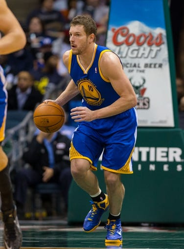 Jan 7, 2014; Milwaukee, WI, USA; Golden State Warriors forward David Lee (10) during the game against the Milwaukee Bucks at BMO Harris Bradley Center.  Golden State won 101-80.  Mandatory Credit: Jeff Hanisch-USA TODAY Sports
