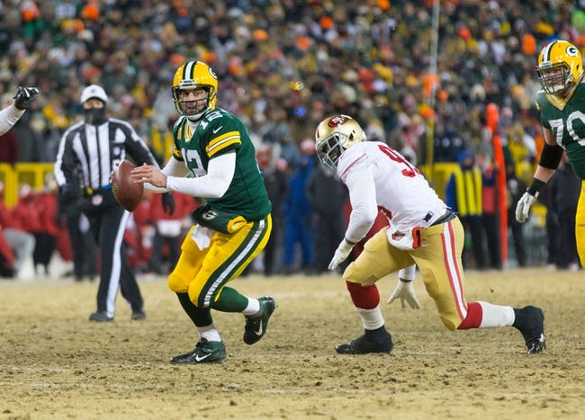 Jan 5, 2014; Green Bay, WI, USA; Green Bay Packers quarterback Aaron Rodgers (12) during the 2013 NFC wild card playoff football game against the San Francisco 49ers at Lambeau Field.  San Francisco won 23-20.  Mandatory Credit: Jeff Hanisch-USA TODAY Sports