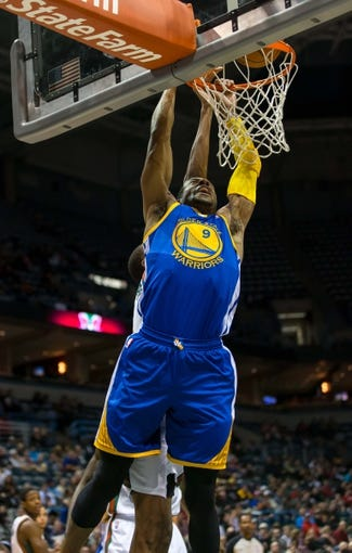 Jan 7, 2014; Milwaukee, WI, USA; Golden State Warriors forward Andre Iguodala (9) during the game against the Milwaukee Bucks at BMO Harris Bradley Center.  Golden State won 101-80.  Mandatory Credit: Jeff Hanisch-USA TODAY Sports