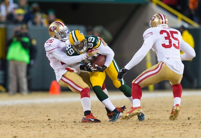 Jan 5, 2014; Green Bay, WI, USA; Green Bay Packers wide receiver James Jones (89) is tackled by San Francisco 49ers cornerback Tramaine Brock (26) during the 2013 NFC wild card playoff football game at Lambeau Field.  San Francisco won 23-20.  Mandatory Credit: Jeff Hanisch-USA TODAY Sports