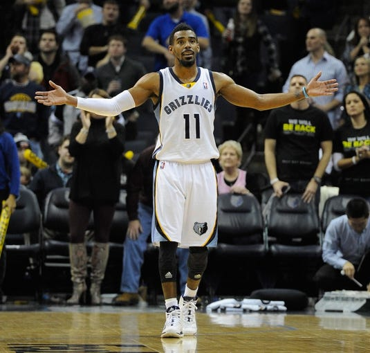 Jan 7, 2014; Memphis, TN, USA; Memphis Grizzlies point guard Mike Conley (11) during the fourth quarter against the San Antonio Spurs at FedExForum. the San Antonio Spurs beat the Memphis Grizzlies 110 - 108 Mandatory Credit: Justin Ford-USA TODAY Sports