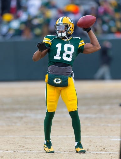 Jan 5, 2014; Green Bay, WI, USA; Green Bay Packers wide receiver Randall Cobb (18) during warmups prior to the 2013 NFC wild card playoff football game against the San Francisco 49ers at Lambeau Field.  San Francisco won 23-20.  Mandatory Credit: Jeff Hanisch-USA TODAY Sports