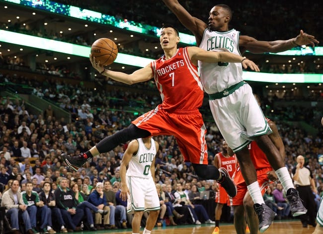 Jan 13, 2014; Boston, MA, USA; Houston Rockets point guard Jeremy Lin (7) drives past Boston Celtics small forward Jeff Green (8) during the first quarter at TD Garden. Mandatory Credit: Winslow Townson-USA TODAY Sports