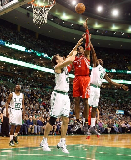 Jan 13, 2014; Boston, MA, USA; Houston Rockets power forward Dwight Howard (12) goes up for a shot between Boston Celtics power forward Kris Humphries (43) and small forward Jeff Green (8) during the first quarter at TD Garden. Mandatory Credit: Winslow Townson-USA TODAY Sports