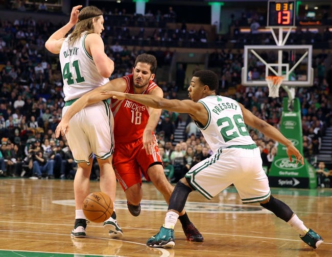 Jan 13, 2014; Boston, MA, USA; Houston Rockets small forward Omri Casspi (18) tries to drive between Boston Celtics center Kelly Olynyk (41) and point guard Phil Pressey (26) during the first quarter at TD Garden. Mandatory Credit: Winslow Townson-USA TODAY Sports