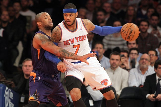 Jan 13, 2014; New York, NY, USA; New York Knicks small forward Carmelo Anthony (7) controls the ball against Phoenix Suns small forward P.J. Tucker (17) during the first quarter of a game at Madison Square Garden. Mandatory Credit: Brad Penner-USA TODAY Sports