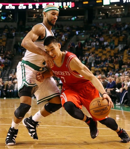 Jan 13, 2014; Boston, MA, USA; Houston Rockets point guard Jeremy Lin (7) drives on Boston Celtics point guard Jerryd Bayless (11) during the second half of Houston's 104-92 win  at TD Garden. Mandatory Credit: Winslow Townson-USA TODAY Sports