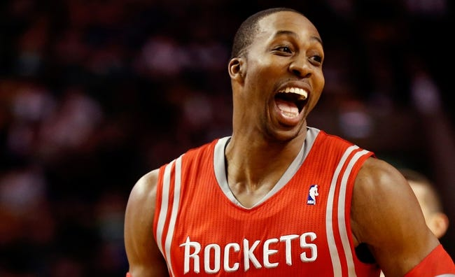 Jan 13, 2014; Boston, MA, USA; Houston Rockets power forward Dwight Howard (12) has a laugh with teammates during the first quarter of their 104-92 win over the Boston Celtics at TD Garden. Mandatory Credit: Winslow Townson-USA TODAY Sports