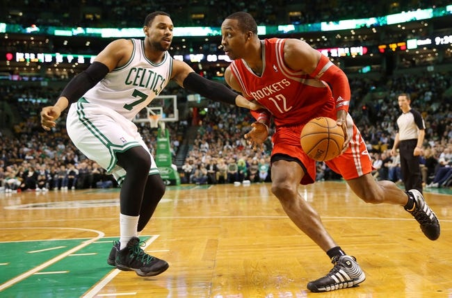 Jan 13, 2014; Boston, MA, USA; Houston Rockets power forward Dwight Howard (12) drives on Boston Celtics power forward Jared Sullinger (7) during the second half of Houston's 104-92 win at TD Garden. Mandatory Credit: Winslow Townson-USA TODAY Sports